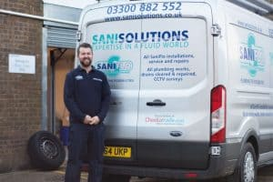 Sani solution approved saniflo engineer stood next to van