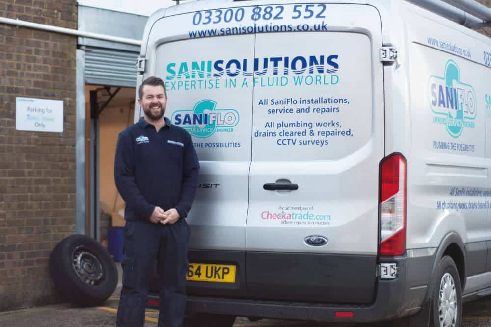 Sani solution approved saniflo engineer stood next to van
